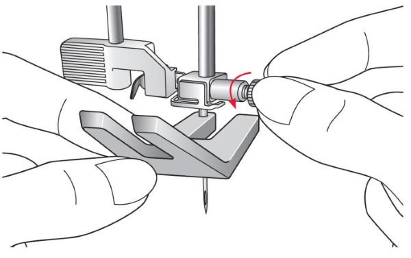 comment coudre un bouton sur un tricot
