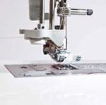 Machine à coudre et à broder Brother Innovis 2600 - Système enfile-aiguille